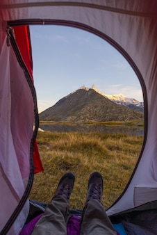View from tent interior  adventure and exploration, outdoor activity.