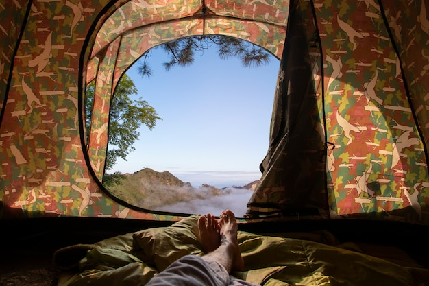 View from tent with mountain view has a beautiful morning mist.