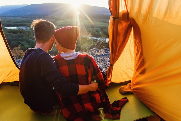 View from the tent of young caucasian couple in love