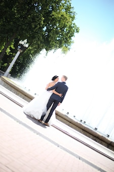 View from the top.the bride and groom standing in front of the fountain.photo with copy space