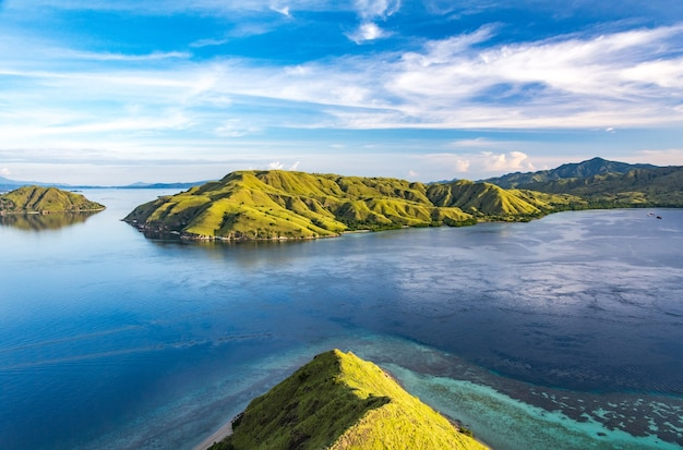 View from the top of gili lawa darat island in the evening with blue sky and blue sea