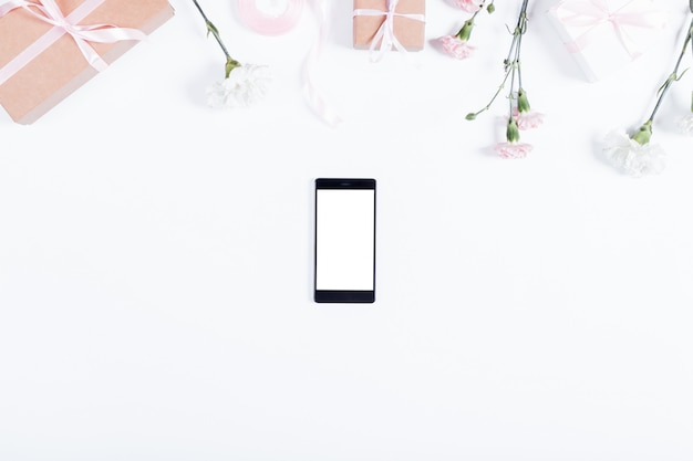 View from the top of the mobile phone and holiday decorations on white table