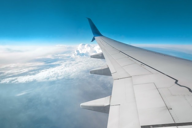 View from the window of a passenger plane above the clouds. international cargo transportation, air travel, transport, air travel, vacations. copy space.