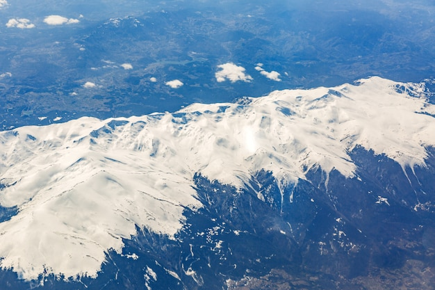 View from the window of the plane that flies over the mountains