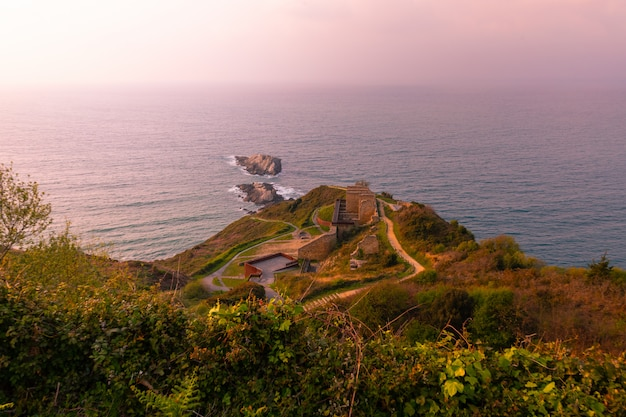View from zarautz with the mouse of getaria at the bottom in a summer sunset, at the pais vasco.