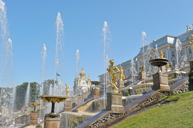 View of the grand palace and the cascade of fountains in peterhof, russia
