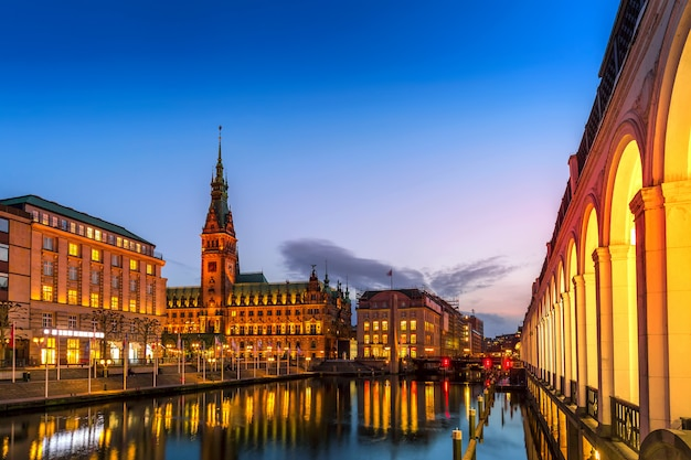 View of hamburg townhall rathaus and small alster lake during twilight sunset.