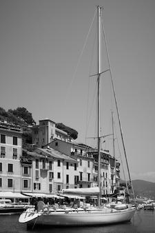 View of the harbor in portofino with a sail boat