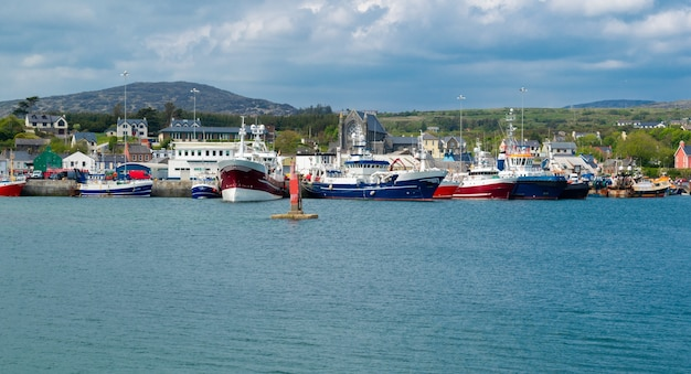 View of harbour with ships and otwn of castletown bere in the south of ireland and the mountains