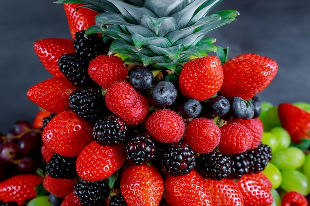 View of healthy berries in rainbow colours, pineapple, blackberries, blueberries