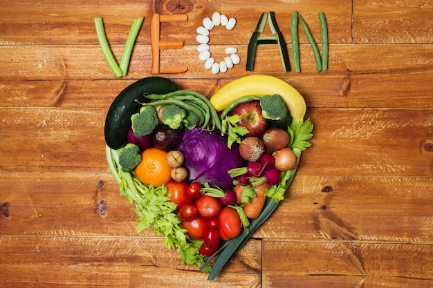 Above view heart shaped vegetable arrangement