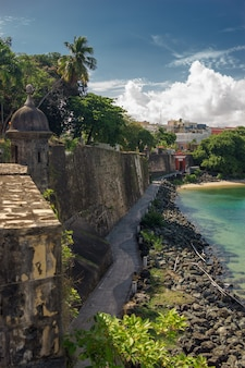 View of historic colorful puerto rico city in distance with protection wall.