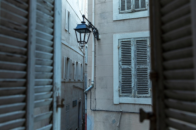 View of the houses in the old town from a window with wooden shutters. close-up.