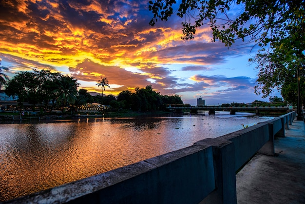 View image landscape of ping river, nawarat bridge chiang mai sunset sky