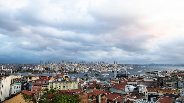 View of the istanbul at cloudy weather, bosphorus strait dividing city into two parts, multiple buildings, new mosque, turkey