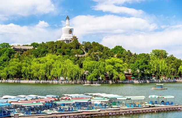 View of jade island with white pagoda in beihai park - beijing, china