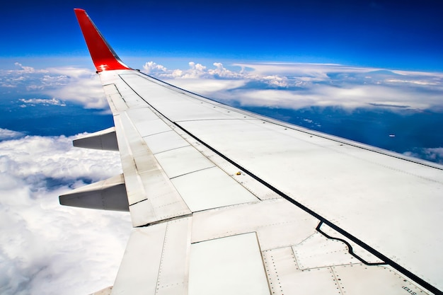 View of jet plane wing with cloud patterns Premium Photo