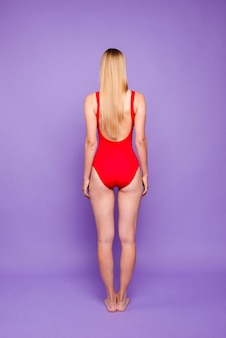 Behind view of lady with long haircut perfect shapes wearing modern stylish swimsuit