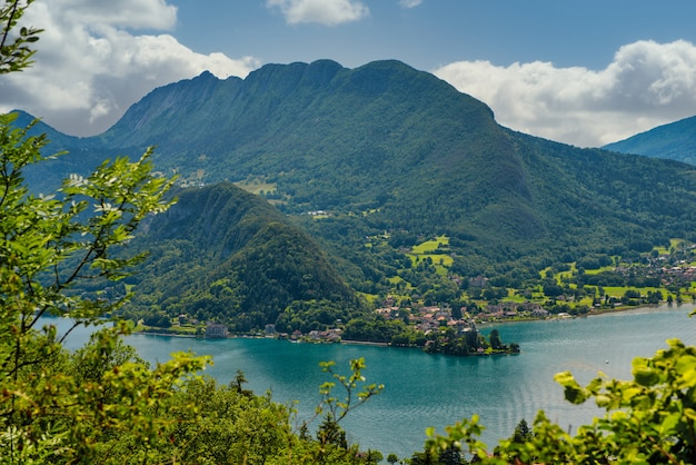 View of lake of annecy with duingt village, french alps