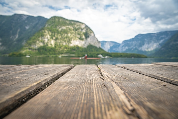View on lake in austrian town hallstatt during tourist season in summer