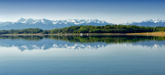 View of  lake gabas in the pyrenees atlantiques, mountains in  background