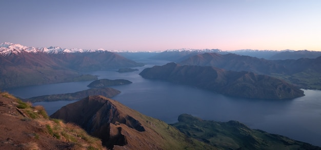 View on lake and mountain summit just before sunrise shot made on roys peak in wanaka new zealand