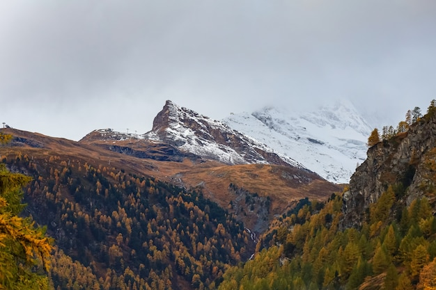 View of landscape snow alp mountain in autumn at swiss