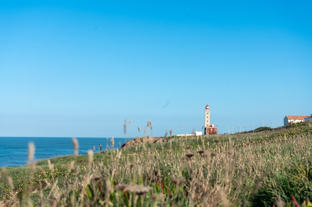 View of the lighthouse on the coast of sao pedro de moel in portugal.