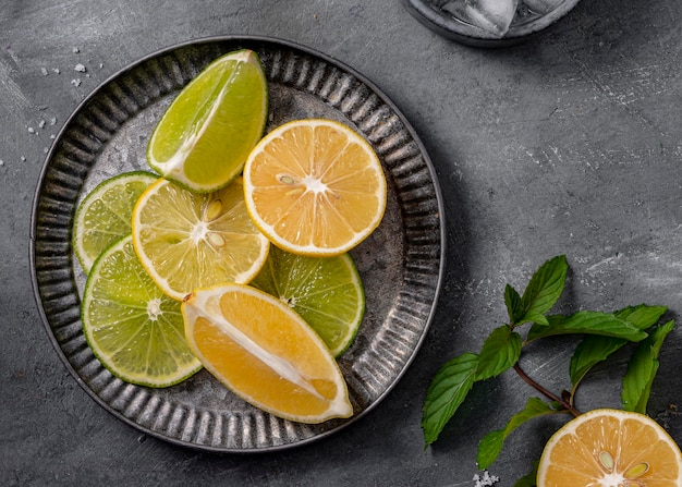 Above view lime and lemon slices on plate