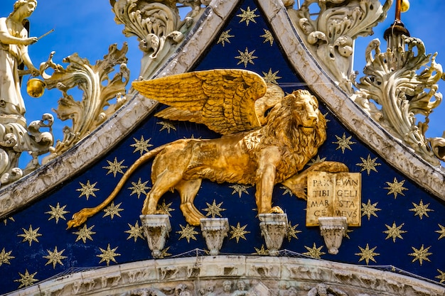View at lion of st mark, symbol of imperial venice on the basilica san marco in italy