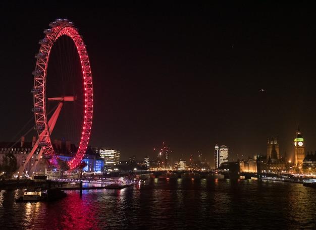 View of london eye at night.