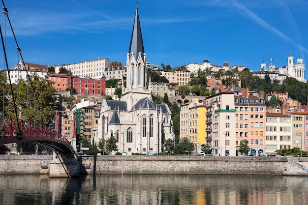 View of lyon city with red footbridge on saone river