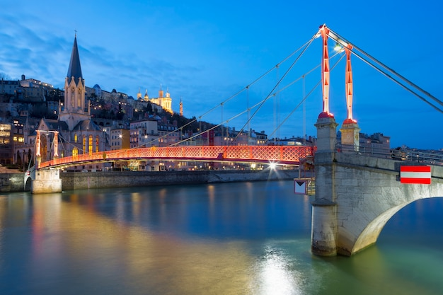 View of lyon with saone river and footbridge at night, france.
