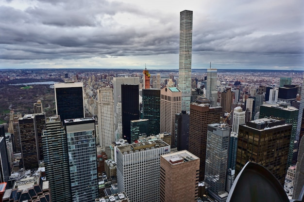 View of manhattan, new york, on a cloudy day. the photo highlights the 432 park avenue condominiums