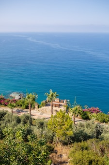 A view of the mediterranean coast with waves of azure water. summer seascape. seaside in sunny weather. beautiful sea view