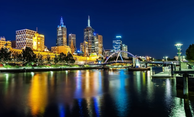 A view of melbourne downtown across the yarra river at night in melbourne, victoria, austr