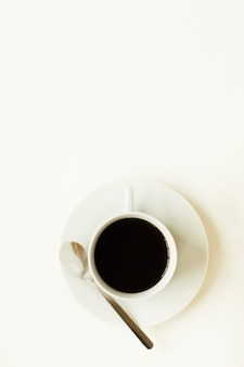 Above view at minimal composition of black coffee cup