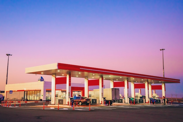 View of modern automobile gas station with cars standing