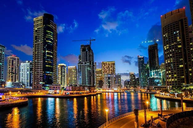 View of modern skyscrapers in jumeirah beach residence in dubai, jbr - artificial canal city, carved along a 3 km on persian gulf shoreline.