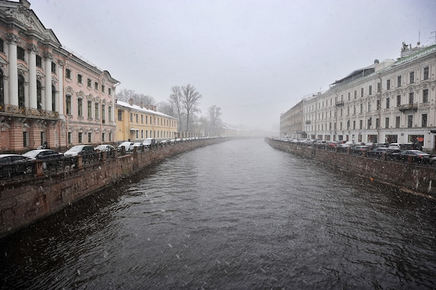 View of the moika river with the nevsky prospekt in rainy cloudy day