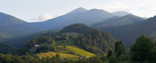 View on morning summer mountain village. five shots stitch image.
