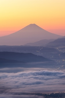 View of mount fuji and sea of mist above suwa lake in morning from takabochi highland