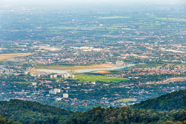 View in the mountains with cityscape over the city of chiang mai, thailand at daytime.