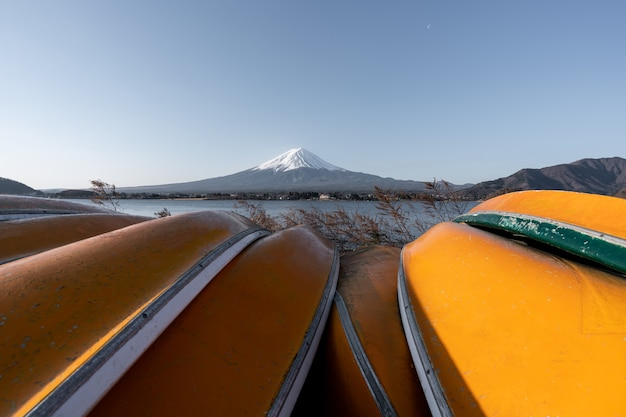 View of mt fuji or fujisan with yellow boat and clear sky