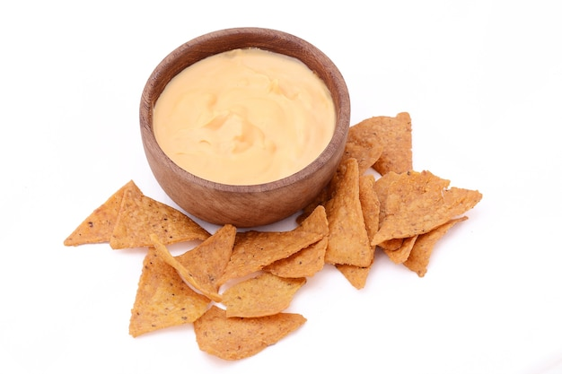 View of nachos with cheese dip