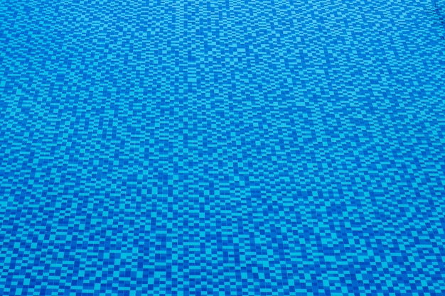 View of nice blue tile in swimming pool water surface