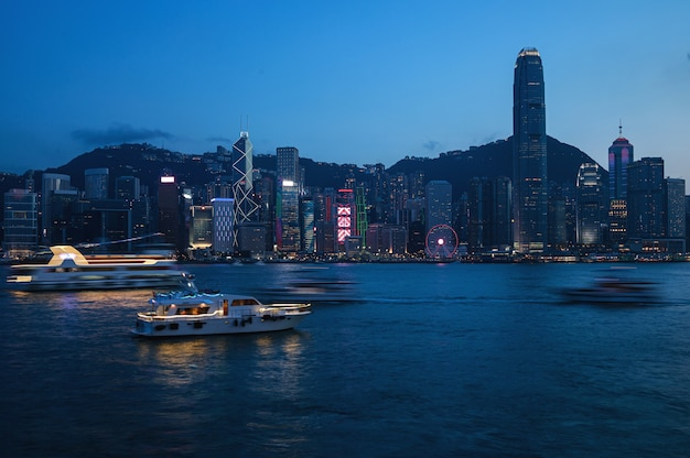 View of the  night modern city. hong kong from the victoria harbour.