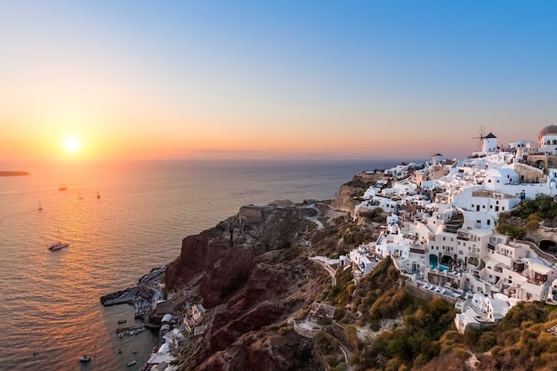View over oia village at sunset, santorini, greece