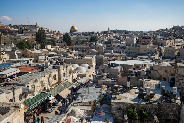 View of old city from ramparts walk with dome of the rock and tower of david in the background, jeru