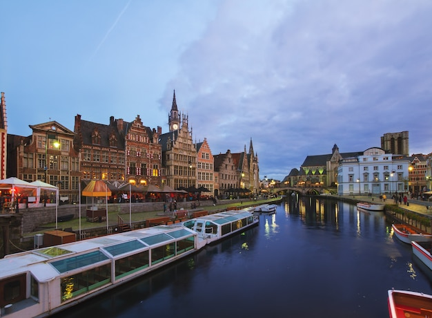 View of old harbour with tourboats moored, ghent, belgium